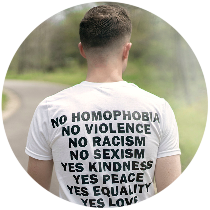 T-shirt that says No homophobia, no violence, no racism, no sexism, yes kindness, yes peace, yes equality, yes love